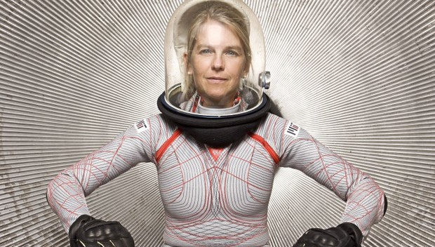 Dr Dava Newman modelling her Biosuit. The biosuit is a tight, form fitting spacesuit with a clear bubble helmet.
