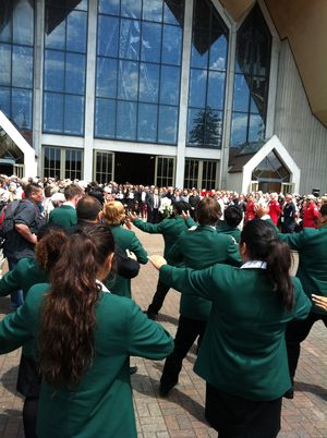 Karamu High School students perform a haka as Sir Paul's casket is brought out of the church.
