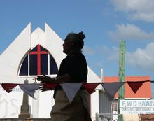 Tongan woman with church behind