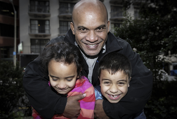 13072016 Photo: Rebekah Parsons-King. Former Nauru opposition MP Roland Kun has left Nauru and arrived in New Zealand after being issued with a New Zealand passport. Pictured with Hana Kun (8 years old) L and Yoshi Kun (6 years old) R.