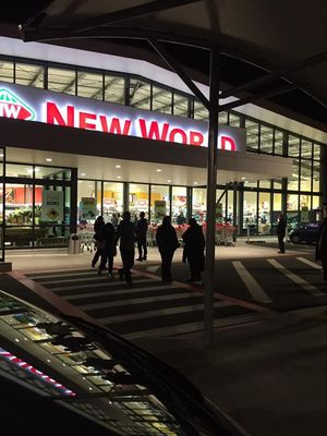 Shoppers gather outside Howick New World after being evacuated.