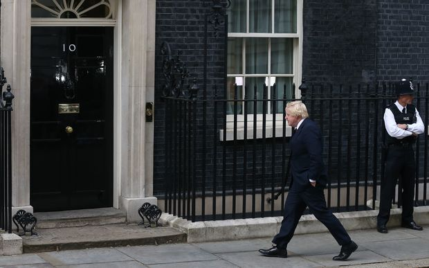 Former mayor of London Boris Johnson walks to 10 Downing Street in central London on July 13, 2016 after New British Prime Minister Theresa May takes office following the formal resignation of David Cameron.