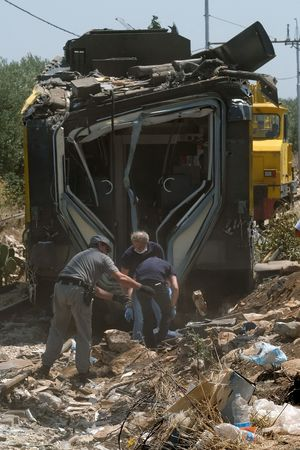 Members of the Italian Dental Division inspect the train crash site on July 13, 2016 near Corato, in the southern Italian region of Puglia as rescuers searched for missing bodies