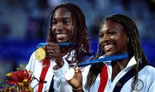 Serena and Venus Williams of USA on the podium with their gold medals for the Womens Doubles Tennis at the Sydney Olympics 2000.