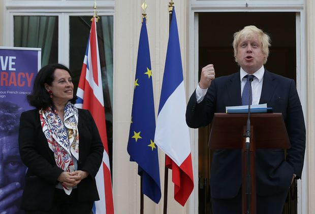 French Ambassador to Britain, Sylvie Bermann (L) listens as British Foreign Secretary Boris Johnson speaks as he attends during a reception at the French Ambassador's residence in west London on July 14, 2016.