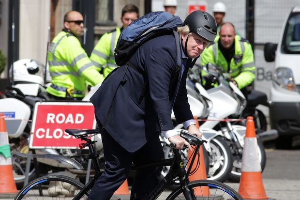 Former Mayor of London, and pro-Brexit supporter, Boris Johnson, rides his bicycle through Westminster in central London on July 6, 2016.