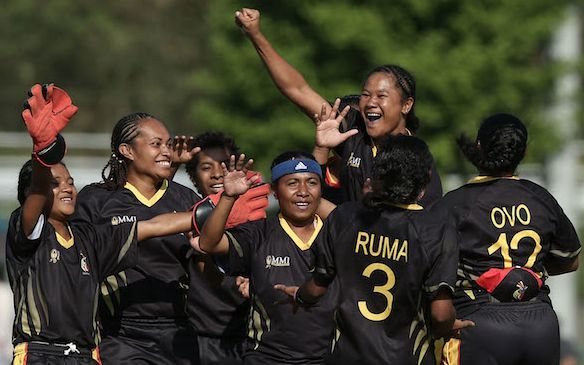 The PNG Lewas celebrate a wicket.
