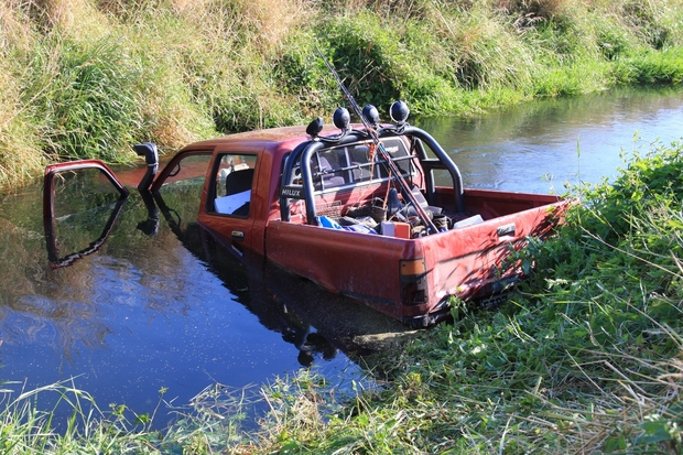 The vehicle as the boys found it in the river with the driver unconscious inside.