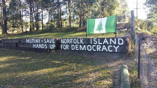 Protesters have been hanging up banners and signs around Norfolk Island