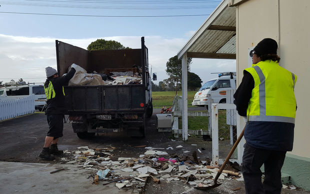 Contractors clear waste from state houses in the New Plymouth suburb of Marfell.