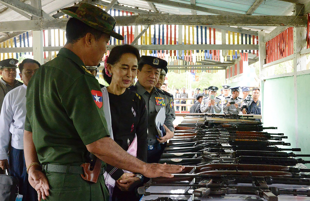 Aung San Suu Kyi accompanied by military and police officials during a visit to a police training school in Yamethin township last month.