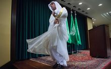 Saudi Foreign Minister Adel al-Jubeir leaves a Washington DC news conference following the release of 28 pages of a 9/11 Congressional report.
