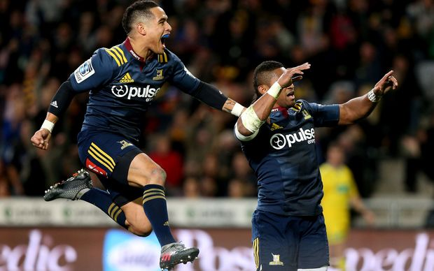 Aaron Smith jumps Waisake Naholo in delight.