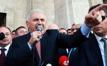 Turkish Prime Minister Binali Yildirim (C) speaks to the public after a meeting with the Turkish Speaker of Parliament in Ankara.