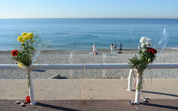 Flowers are tucked to a fence near the spot where someone was killed on Promenade des Anglais in Nice, France, July 17, 2016, when a truck drove into a crowd during Bastille Day celebrations.