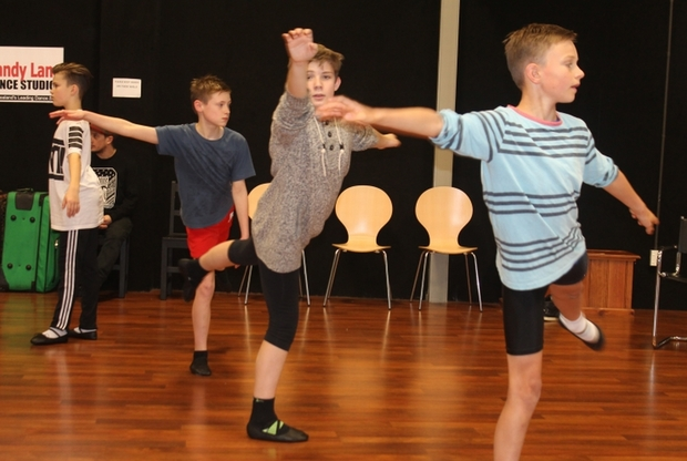 An image of Christian Swan, Daniel Bridgman, Stanley Reedy and Harry Sills dancing in ballet class.