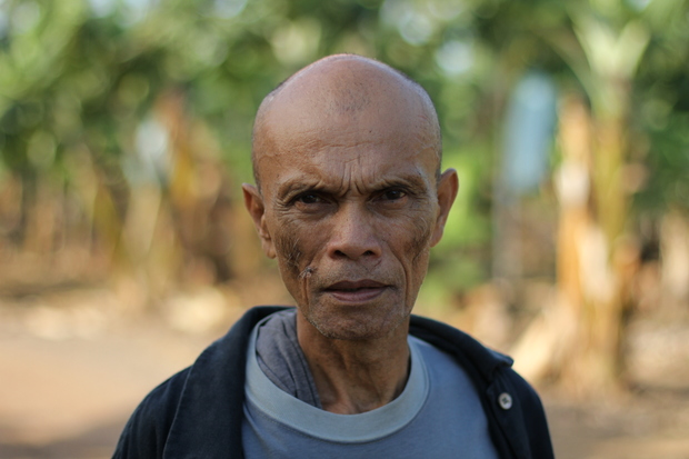 Francisco B. Milallos, 65, has spent much of his life working on the banana plantations of Mindanao