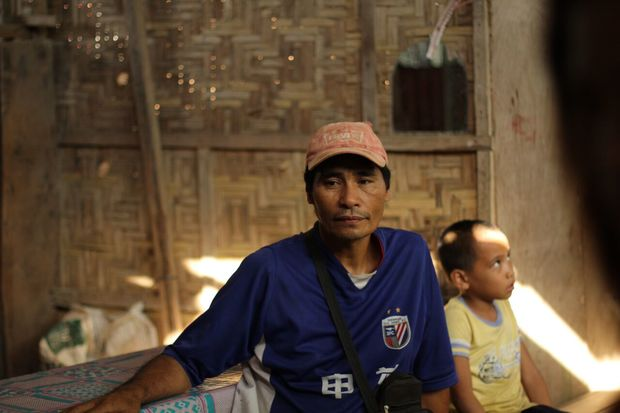 """I think that my children will follow my footsteps"": Vincente Barrios sits in his home with his youngest son."