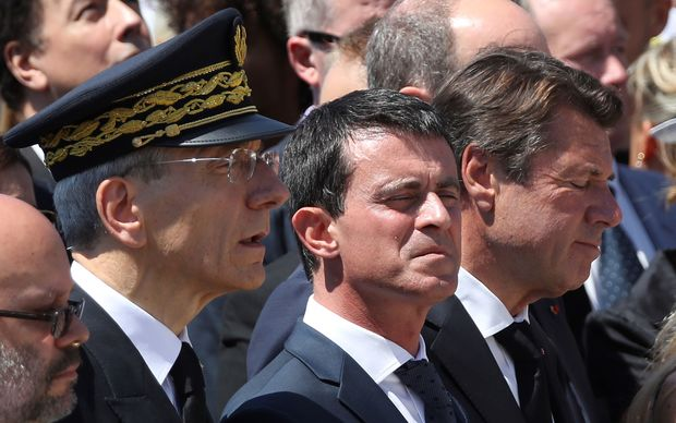The mayor of Nice Philippe Pradal, Prefect of the Alpes-Maritimes department Adolphe Colrat, French Prime minister Manuel Valls and President of the Provence Alpes Cote d'Azur region Christian Estrosi observe a minute of silence on the Promenade des Anglais in Nice on July 18, 2016,
