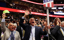 Former Virginia Attorney General Ken Cuccinelli, left, along with other delegates from Virginia chant for a rule call vote on the first day of the Republican National Convention.