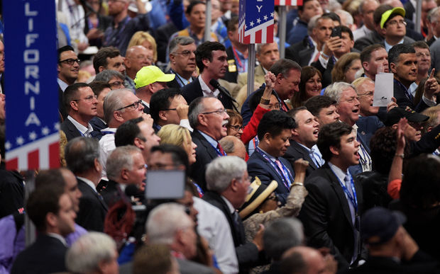 Delegates at the Republican convention react to a proposal for a rules committee vote.