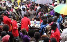 People gather at a stall at the inaugural Bougainville Chocolate Festival