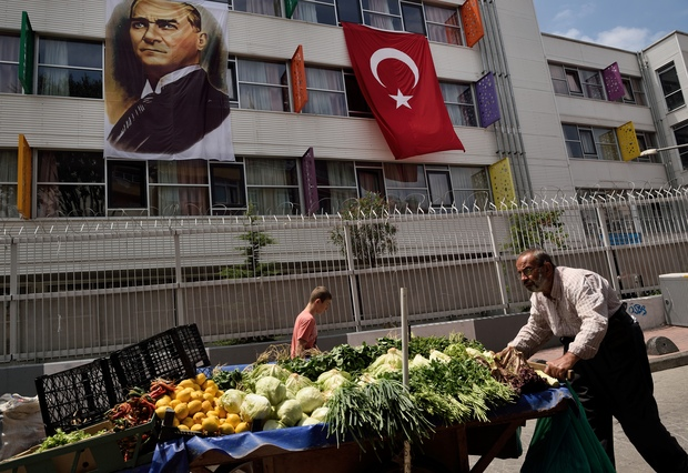 A street seller pushes his cart with fruits and vegetables next to a religious school in the Kasimpasa neighborhood in Istanbul where Turkish President Recep Tayyip Erdogan was born.