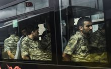 Detained Turkish soldiers who allegedly took part in a military coup arrive in a bus at the courthouse in Istanbul on 20 July.