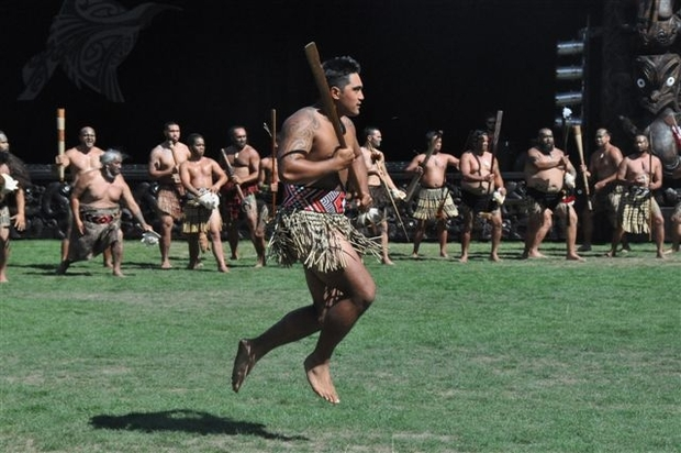 A Te Arawa warrior gives a wero ( challenge) at the welcoming ceremony.