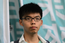 Pro-democracy political activist and member of the Demosisto party Joshua Wong looks on after leaving the Eastern Court in Hong Kong on July 21, 2016.