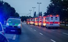 Police cars and ambulances are seen near the shopping mall in Munich following the shootings.