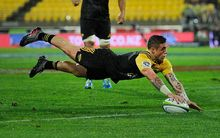 TJ Perenara dots down for the Hurricanes against the Sharks in Wellington.