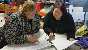 Karen Quak (left) and Robyn Rust coordinate what streets to search next.