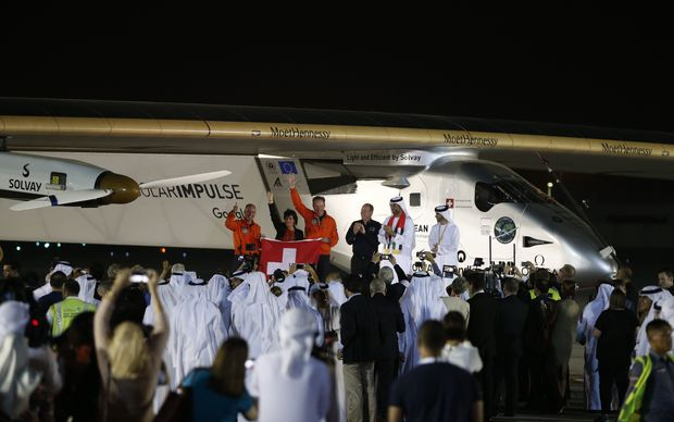 Solar Impulse 2, the solar powered plane, and crew are greeted upon arrival at Al Batin Airport in Abu Dhabi.