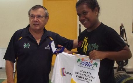 The OWF's Paul Coffa making a presentation to a Solomons student at a recent camp.