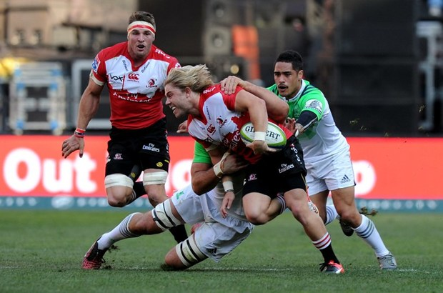 Faf de Klerk is tackled by Aaron Smith during the semi-final match.