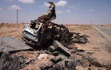 The wreck of a vehicle used by an Islamic State suicide bomber, near Sirte.