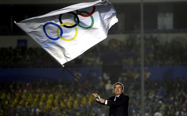 The President of the International Olympic Committee Thomas Bach waves the Olympic Flag during the closing ceremony of Nanjing 2014 Youth Olympic Games in Nanjing, capital of east Chinas Jiangsu Province, Aug. 28, 2014.
