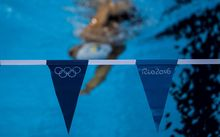 A swimmer practices at the Olympic Aquatics stadium, in Rio de Janeiro, ahead of the 2016 Olympic games.