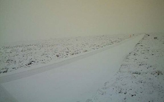 Desert road covered in snow