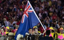 New Zealand flag bearers Blair Tuke and Peter Burling take a selfie during the opening ceremony at Maracana Stadium.