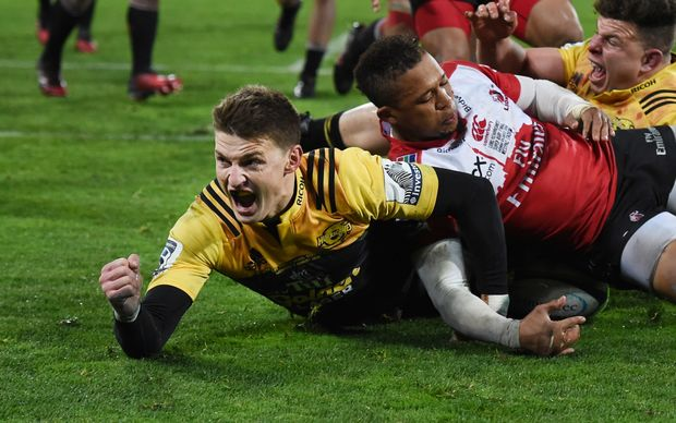 Hurricanes player Beauden Barrett celebrates scoring a try during the