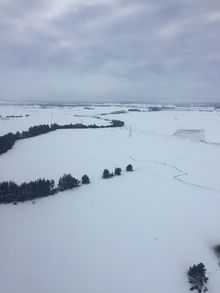SH5 can just be seen under a blanked ot snow at Rangitaiki.