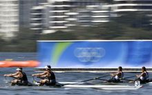 New Zealand's Robert Manson and Christopher Harris compete against an Azerbaijan pair in the men's double sculls on 6 August.
