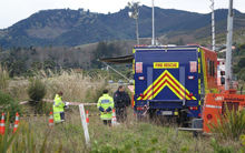 Forensics and police investigators examine the scene where John Murray Morton's body was found in Nelson Haven beside SH6 in Atawhai.