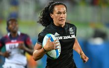 New Zealand's Portia Woodman scores a try in the women's rugby sevens quarter-final match between New Zealand and USA during the Rio 2016 Olympic Games at Deodoro Stadium in Rio de Janeiro on August 7, 2016.