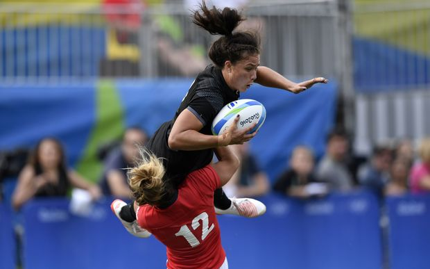 Ruby Tui is tackled by Great Britain's Amy Wilson Hardy in the semi-final.