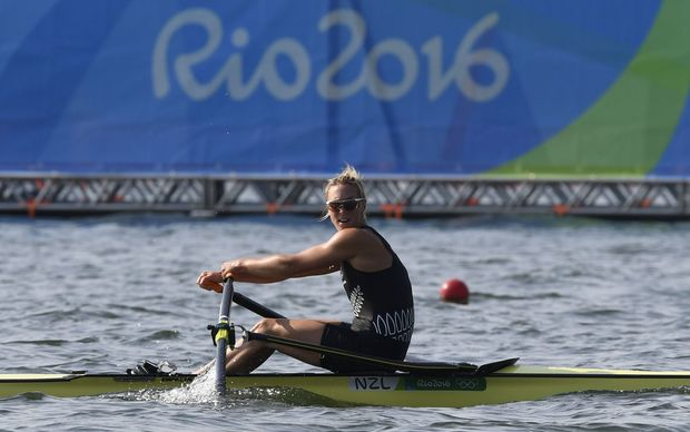 New Zealand's Emma Twigg rows during the Women's Single Sculls Quarterfinal rowing competition at the Lagoa stadium during the Rio 2016 Olympic Games in Rio de Janeiro on August 9, 2016.