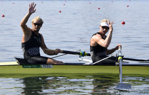 Hamish Bond and New Zealand's Eric Murray (L) wave after the Men's Pair Semifinal rowing competition