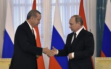 Recep Tayyip Erdoganshakes hands with Vladimir Putin during their press conference in Konstantinovsky Palace.